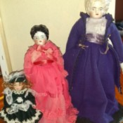 Identifying Porcelain Dolls - three dolls, two very old style