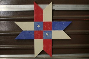 Wooden Barn Star Quilt Pattern - red, white, and blue star with two white stars on blue center squares