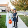 Two tween girls trick or treating.