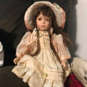 Value of a Porcelain Doll - doll wearing a long pink dress