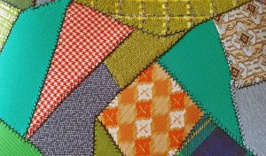 A crazy quilt made from scraps of material.