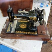 Value of a Vintage Hamilton Beach Sewing Machine - black and gold decorated vintage sewing machine in wood carrying case