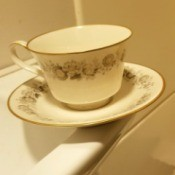 Finding the Value of Crown Victoria Tea Cup - cup and saucer  with a floral pattern and gold rims