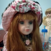 Identifying a Greek Porcelain Doll - red haired doll with a pink plaid and floral outfit