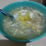 a bowl of corn and mushroom soup.