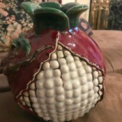 Is This a Majolica Vase? - globe shaped vase that looks a bit like a round corn cob with white kernels, purple covering from top down and around the entire back