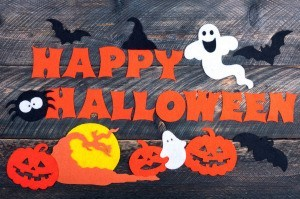 Happy Halloween spelled out with cut paper.
