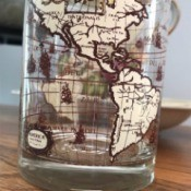 Identifying Drinking Glasses - glass with the continents around the outside