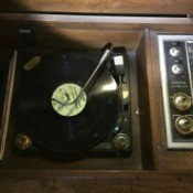 Value of a Zenith Stereo Console - open console with record on the turntable