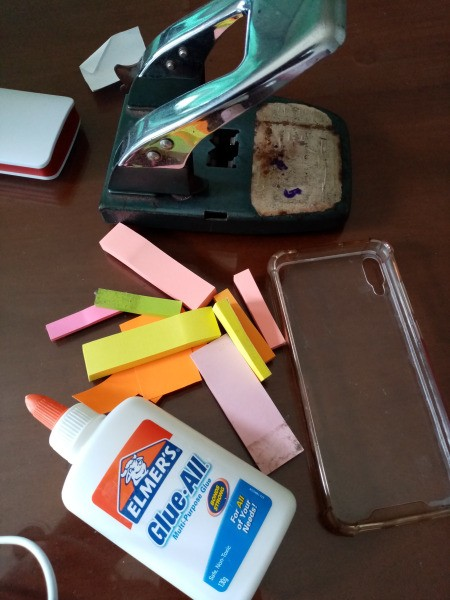 Fixing Jelly Phone Case with Sticky Notes - supplies