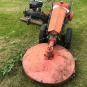 A vintage riding lawnmower