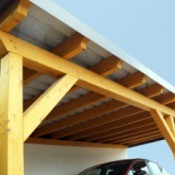 A carport with wood supports and a metal roof.