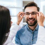 A man trying out new eyeglasses.