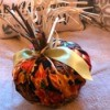 Crafty Toilet Paper Roll Pumpkins  - pumpkin made with a square of fabric with fall gourd pattern