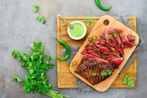 Flank steak on cutting board