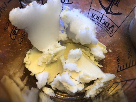 DIY Workout Enhancer Lotion - shea butter and coconut oil in microwaveable bowl