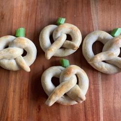 Pretzel Pumpkins - 4 finished pretzels on a tabletop