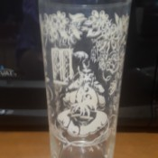 Value of a Vintage Drinking Glass - tall glass with white pattern of woman with umbrella perhaps in a garden