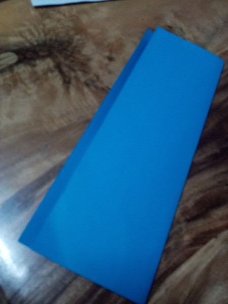 Halloween Hand Puppet - fold a piece of paper lengthwise leaving a half inch strip to fold over