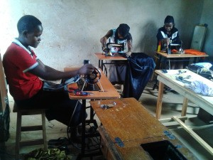 Finding Donated Fabric for Youth Training Program - teens using treadle sewing machines