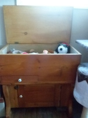 Identifying a Piece of Vintage Furniture - perhaps a homemade chest with a top that lifts for storage, a small drawer on the left and a door on the bottom with storage behind it