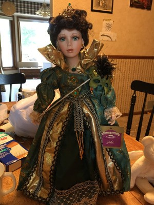 Value of a Collectible Memories Porcelain Doll - doll wearing a green ball gown