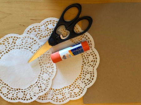 Paper doilies, scissors and glue.