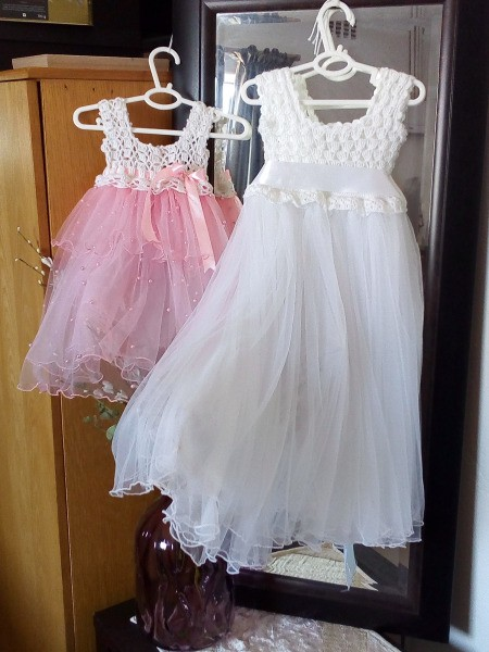 Crocheted bodice dresses for a young girl.