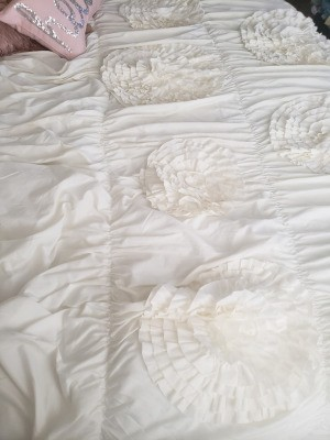 Repairing a Comforter - white comforter with raised flowers