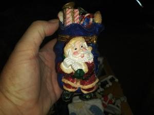 Value of a Cardinal Inc. Santa Trinket Box - hand holding colorful Santa trinket box