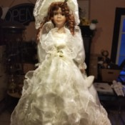 Value of a Knightsbridge Collection Porcelain Doll - doll wearing a long white dress covered in lace