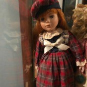 Value of a Century Collection Porcelain Doll - doll wearing a plaid dress and matching hat