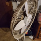 Repairing a Pedestal Fan - fan with one side open to get to blades