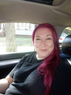 Darkening Dyed Hair - woman with rather bright red hair