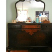 Value of a Vintage Dresser with Mirror - dark finish dresser with lighter veneer pattern in middle of  drawers