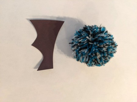 Pom Pom Bat Decoration - cut two wings from black construction paper