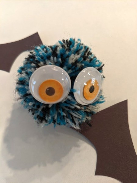 Pom Pom Bat Decoration - glue googly eyes to pom pom