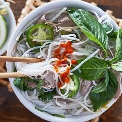 A bowl of Asian noodle soup.