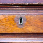 An old desk drawer with a lock.