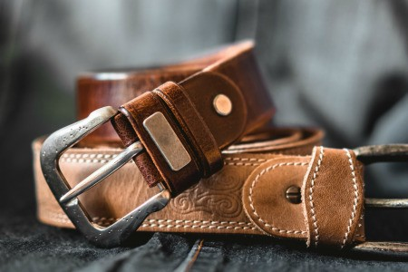 Two leather belts.
