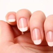 Nails with a beautiful French manicure.