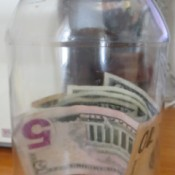 Money in a recycled plastic mayo jar.
