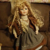 Value of Porcelain Dolls - doll with long blond braids
