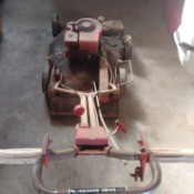 Value of a Vintage Cooper Cyclo-vac Lawn Mower - red gas powered vintage mower