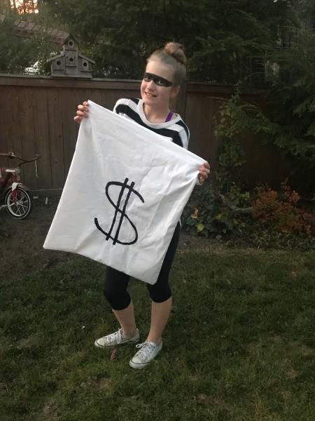 Easy Burglar Costume  - girl burglar holding a white money bag
