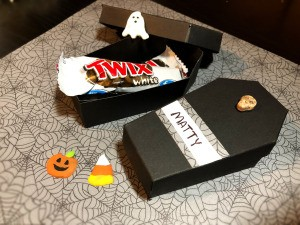 Paper Coffin Treat Boxes - open coffin with candy and other Halloween decorations