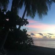 A tropical sunset on a beach in Tahiti.