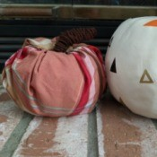 Fabric Covered Foam Pumpkin - finished pumpkin sitting next to a white pumpkin with painted triangle pattern