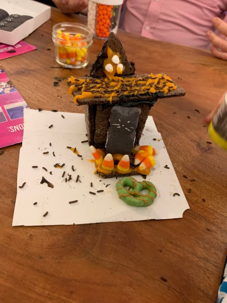 Haunted Gingerbread House - decorated graham cracker house on a piece of white paper