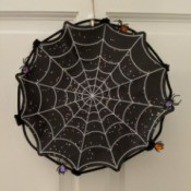 Halloween Spiderweb Placemat Wreath - finished wreath hanging on a door
